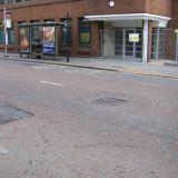 Tarmac sinking around sunken manhole cover