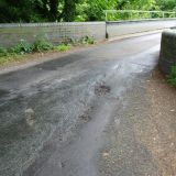 7/6/2011 Pothole at Station Lane Bridge.
