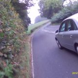 4/10/2015 Still not touched and dangerous. Forced to ride well out from the edge cars pass dangerously close.