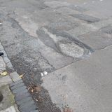Awful band of rough road spanning both directions which are always being refilled, rather than resurfaced